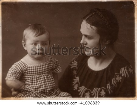 Russian vintage photograph, beginning of XX century. Family. Young woman and baby