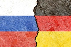 Russian VS Germany national flags symbol isolated on weathered broken cracked cement wall background, abstract Russia Germany international politics conflicts pattern concept texture wallpaper