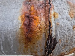 Rust and corrosion in the pipeline and metal skin.Corrosion of metal.Rust of metals.Old pipeline .Rust from Welds steel.