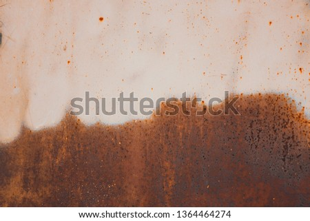 rust and erosion on metal sheet half area surface