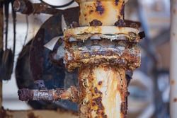 Rust damage paint and corrosion flange and bolt nut on pipeline drain industrial.