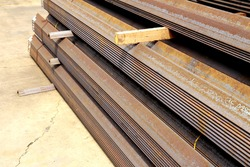 Rust steel angles bunch in warehouse for raw material Steel Transmission line tower