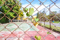 Rust steel  mesh at the tennis court for background. rust steel mesh. No people at the tennis court No maintenance or repairs. safety concept