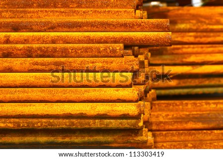 Rust steel rod in warehouse.