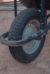 rust wheel of a wheelbarrow Pushcart