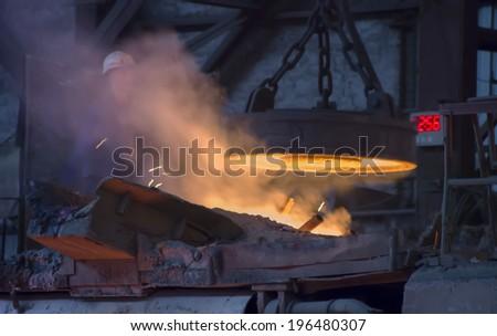 RUSTAVI, GEORGIA - May 1, 2014: Hot steel pouring in Rustavi Metallurgical Plant, Georgia