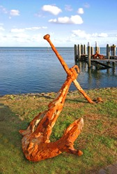 Rusted anchor by the sea in West-Terschelling, Terschelling island, The Netherlands