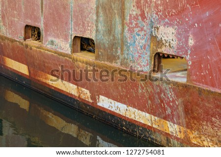 Rusted and beat up hull of one of New Jersey's fishing fleet boats in Barnegat