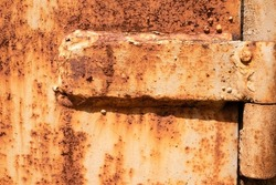 Rusted background. old textured for your work. Brown, black, and yellow rust. Corroded white metal background. Rusty metal surface with streaks of rust.