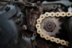 rusted bolt on front sprocket of motorcycle with new chain, mechanic change sprocket and chain concept, repair concept