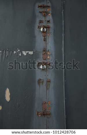 Rusted bolted door & Shutterstock - PuzzlePix