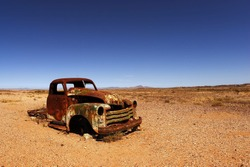 rusted car hood in the African desert
