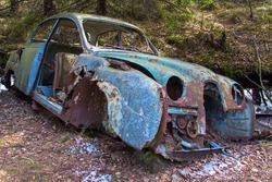 Rusted car wreck in the woods