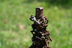 rusted chain on rusted pole detail
