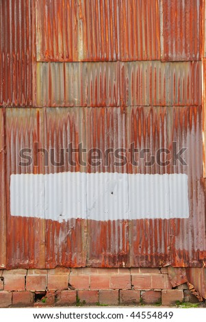 rusted corrugated metal wall of a warehouse building in a industrial district of Portland Oregon
