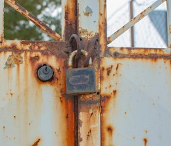 rusted door and lock. An orphaned house. loneliness.