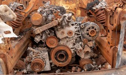 Rusted engine of an old abandoned car. Symbol of entropy