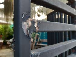 Rusted house fence, peeling paint