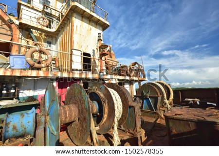 Rusted hull equipment on the outside of the stranded ship