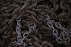 rusted iron chain found in an industrial area
