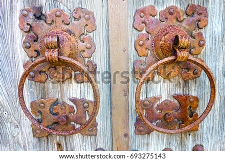 rusted locks on old wood gate...