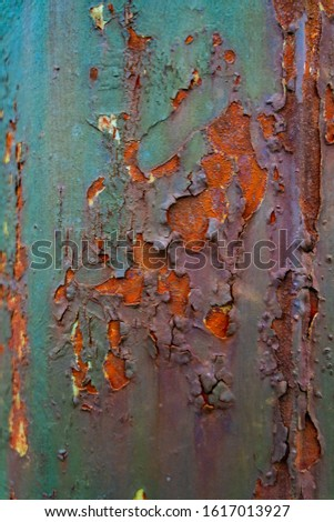 Rusted metal corrugated metal background. Rusty metal background with streaks of rust. Rust stains.