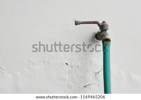 Rusted metal faucet,Excessive moisture can cause mold and peeling paint wall, such as rainwater leaks or water leaks. #1169465206