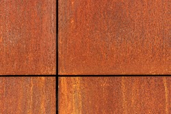 Rusted metal plates with crosswise border lines. Rusty metal surface. Iron corroded texture background.