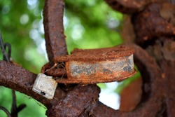 rusted old vintage lock on fence. close up.
