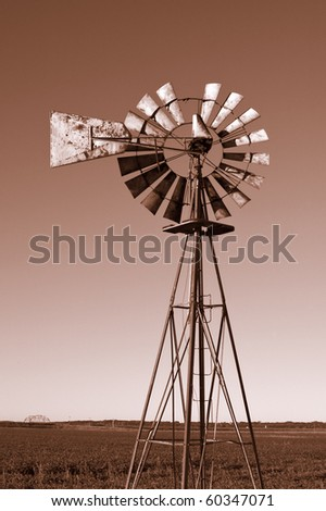 Rusted old Windmill with a sepia tone and copy space