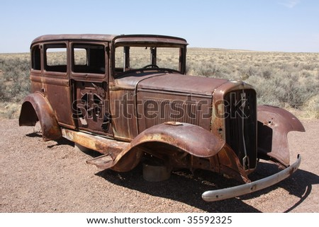 Rusted out old car - stock photo