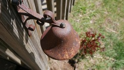 Rusted outdoor bell on porch