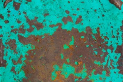 Rusted painted steel background. High resolution image of rusted blue abstract texture. Corroded turquoise color paint metal backdrop. Aqua blue paint with streaks of rust. Rusty corrosion.