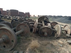 Rusted Scrapped wheel assemblies at a junkyard of railway