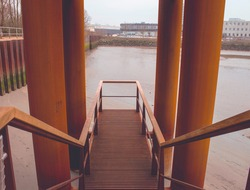 rusted staircase down to the water