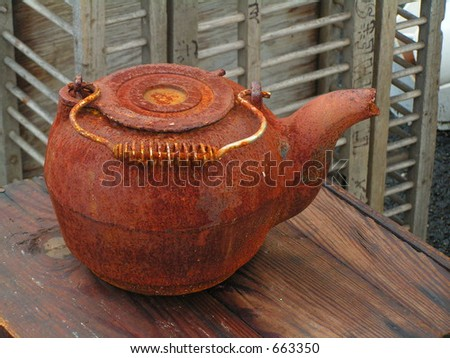 RUSTED TEA POT AT FAMILY ANTIQUE BUSINESS - stock photo