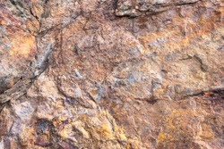 Rusted texture. Rusted background. Granite rocks. Colorful Rock background. Old Cracked Rusty Rough texture. Rock wall backdrop with rough red brown texture. Grunge Abstract Stone Surface.