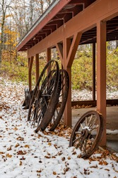 Rusted wagon wheels by building