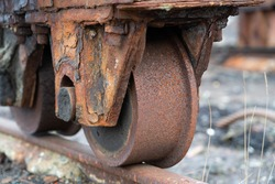 rusted wheels on rusty rails of a disused railway - close-up