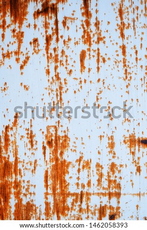 Rusted white painted metal wall. Rusty metal background with streaks of rust. Rust stains. Rust texture. #1462058393