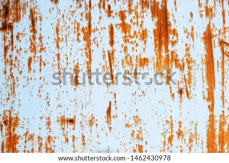 Rusted white painted metal wall. Rusty metal background with streaks of rust. Rust stains. Rust texture. #1462430978