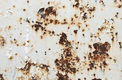 Rusted white painted metal wall. Rusty metal background with streaks of rust. Rust stains. The metal surface rusted spots