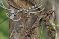 Rustic and corroded barbed wire fence, selective focusing