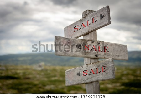 Rustic and wooden Sale signpost outdoors in Nature. Sales, sale, shop, shopping, direction, company, store concept. #1336901978