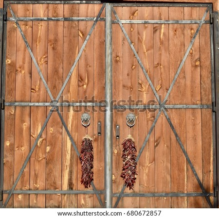 Rustic Barn Doors With Decorative Chili Peppers 680672857