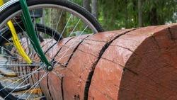 Rustic bike rack. Bicycle Parking Stand Made From the Trunk. bicycle parking was made from a large log.