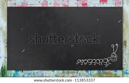 Rustic Blackboard and a Chalk Drawing of a Caterpillar