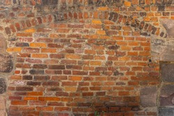 Rustic brick wall with ornamental arch in various sized cutouts as background