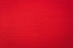 Rustic canvas fabric texture in red color.