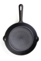 Rustic Cast-iron frying pan, isolated on white background. High resolution image.